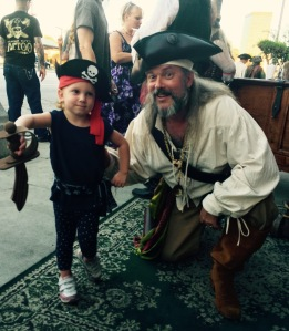 Ol' Chumbucket greets a three-year-old pirate at Saturday's Talk Like a Pirate Day party in Studio City, Calif.