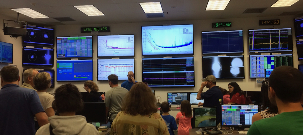 The LIGO control room. These monitors – and more to the left and right plus the banks of monitors at the work stations – keep track of what's going inside the massive detector.
